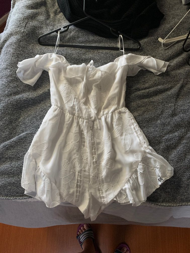 Cute White play suit size 8(can fit up to size 12) is it is stretchy