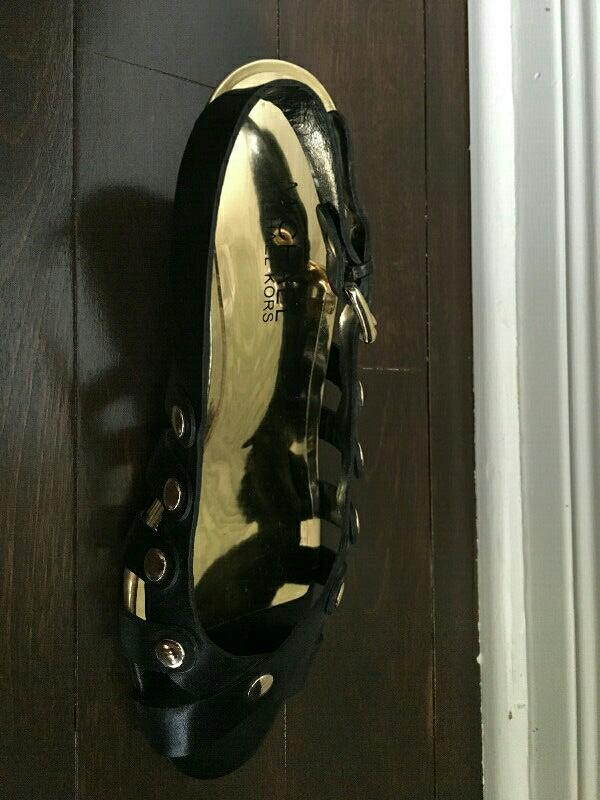 Michael Kors black leather sandals with gold accent