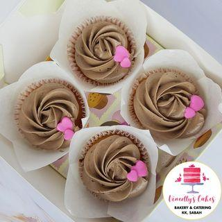 Simple chocolate frosted cupcakes