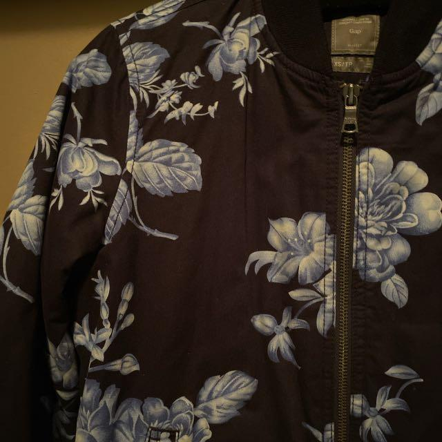 Gap Bomber style Jacket. Navy with blue floral print. The jacket is warm great layering piece for now and on its own in the spring. Size Small