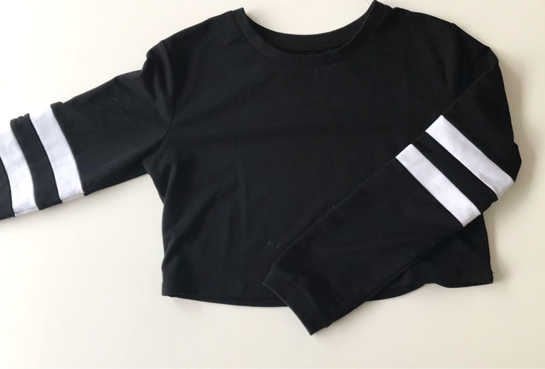 Long sleeve black with white contrast detailing arm