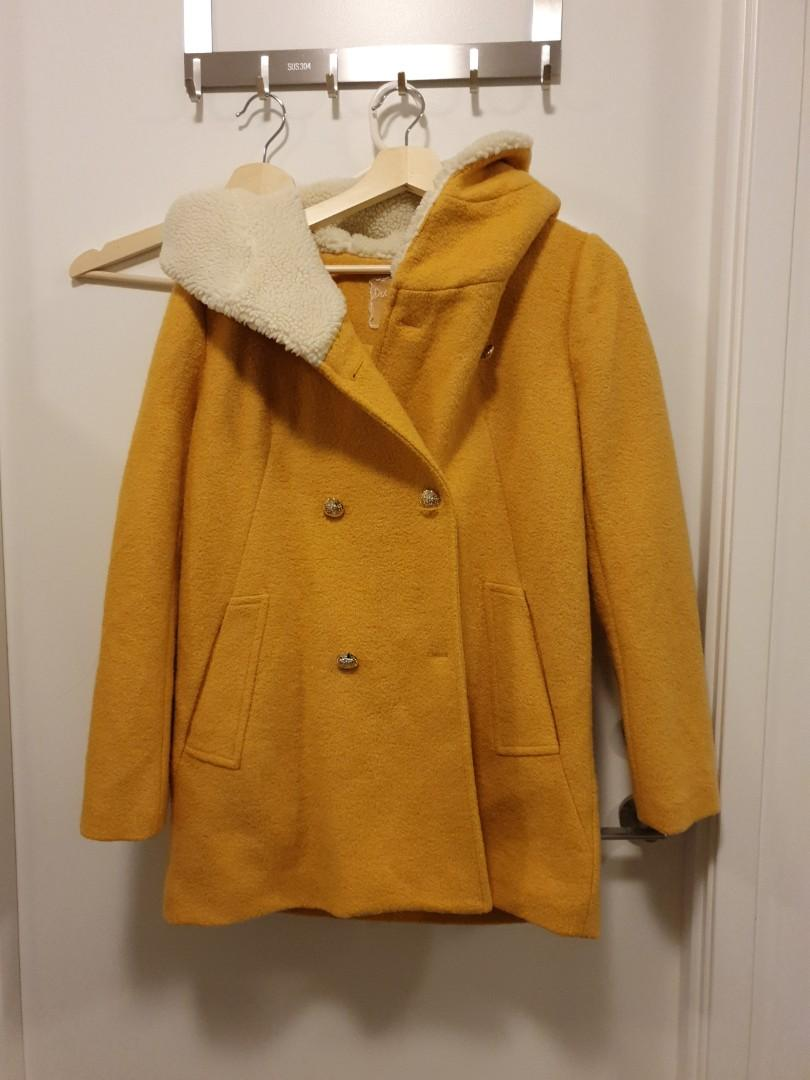 Yellow winter jacket with hoodie