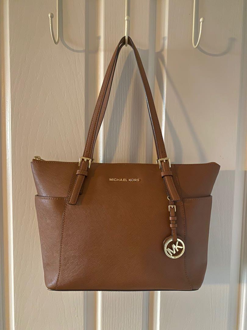 Used authentic Michael Kors large jet setter tote (brown)