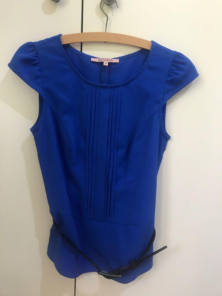 Review  short sleeve blue top, zip back with black belt size 8