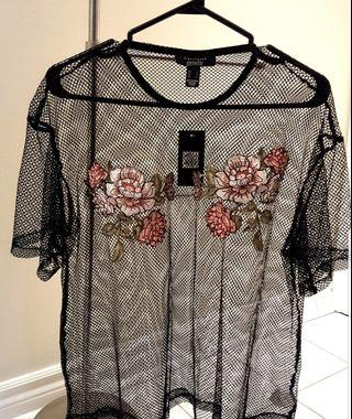 Mesh top with floral embellishments