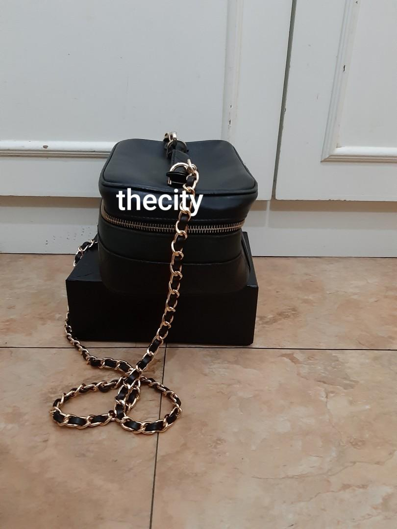 AUTHENTIC CHANEL BLACK LAMBSKIN LEATHER VANITY BAG- WITH EXTRA LONG CHAIN STRAP FOR CROSSBODY SLING- EXTERIOR LAMBSKIN LEATHER IN GOOD CONDITION,  CLEAN INTERIOR, SMALL SCUFF INSIDE - (CHANEL VANITY BAGS NOW RETAIL OVER RM 15,000+)