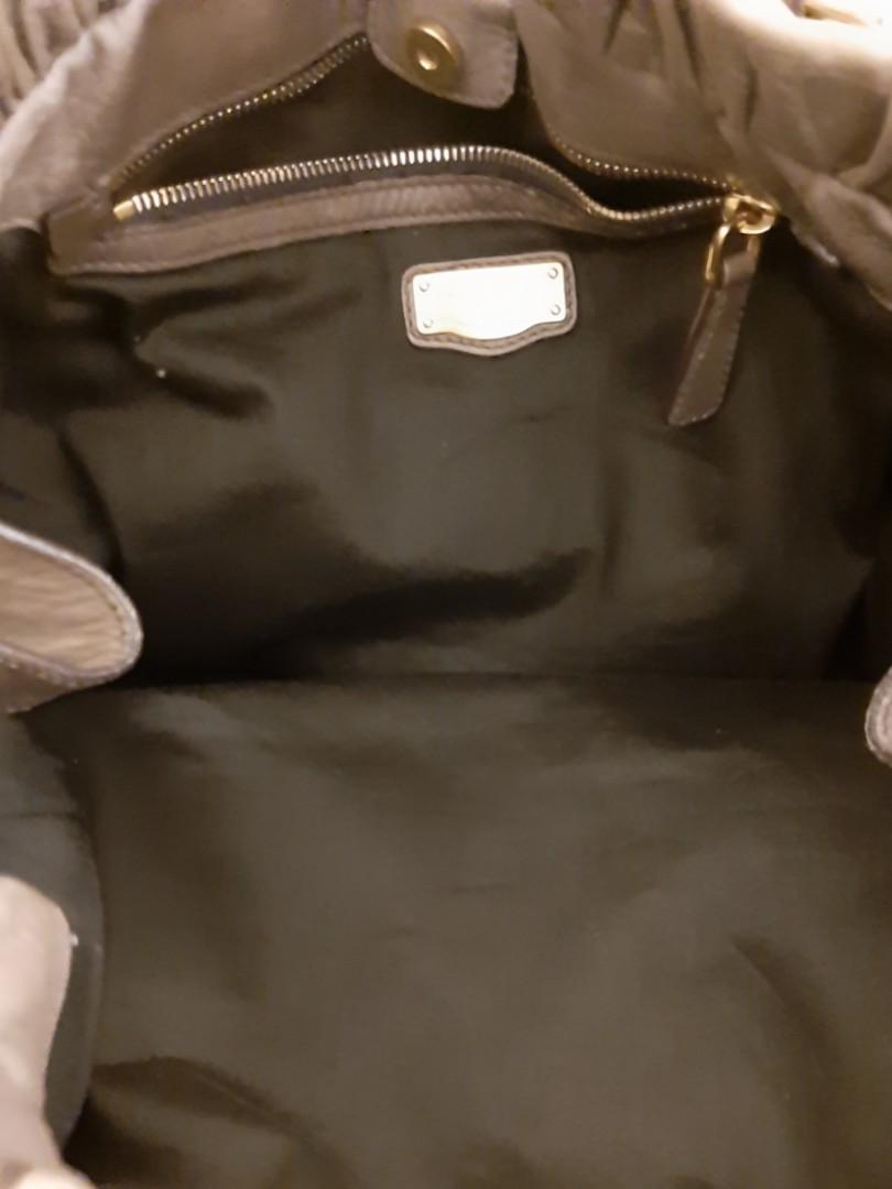 AUTHENTIC MIU MIU LEATHER BIG TOTE BAG,  COMES WITH ITS ORIGINAL LONG STRAP FOR CROSSBODY SLING - GREY COLOUR- OVERALL GOOD,  CLEAN INTERIOR & POCKETS - (BOUGHT AROUND RM 6000+)