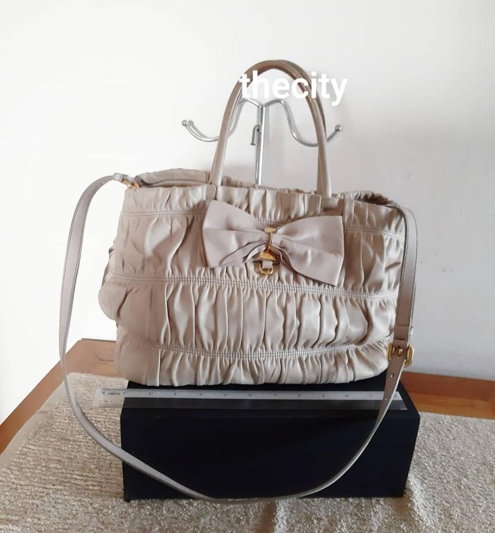 AUTHENTIC PRADA NAPPA GAUFRE LAMBSKIN LEATHER TOTE BAG , COMES WITH ITS ORIGINAL LONG STRAP FOR CROSSBODY SLING - CLEAN INTERIOR & POCKETS- EDGES CAN TOUCH UP AT BAG SPA - COMES WITH AUTHENTICITY CARD , (YEAR 2010 MODEL PRADA) - (BOUGHT OVER RM 6000+)