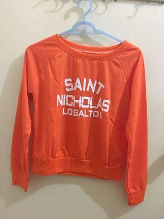 全新橘色上衣