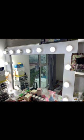 Vanity mirror with rack