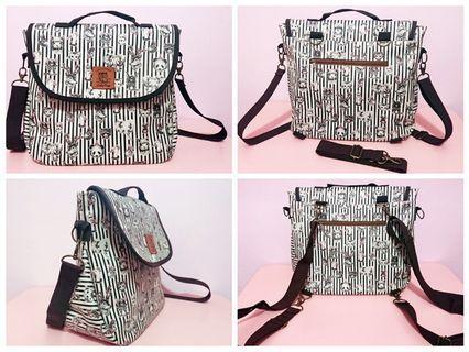 包包Dolly Club朵莉 後背包 斜背包 手提包 三用包 防水包(隨包附兩條可拆式長繩) 可愛動物直條圖樣  女生包包#剁手時尚