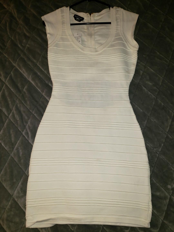 Bebe white bandage dress. Size Medium -new with tags