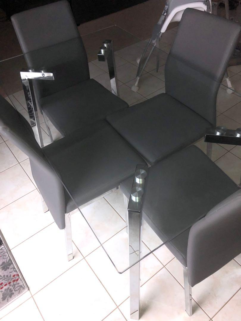 Glass dining table set with leather chairs for sale.