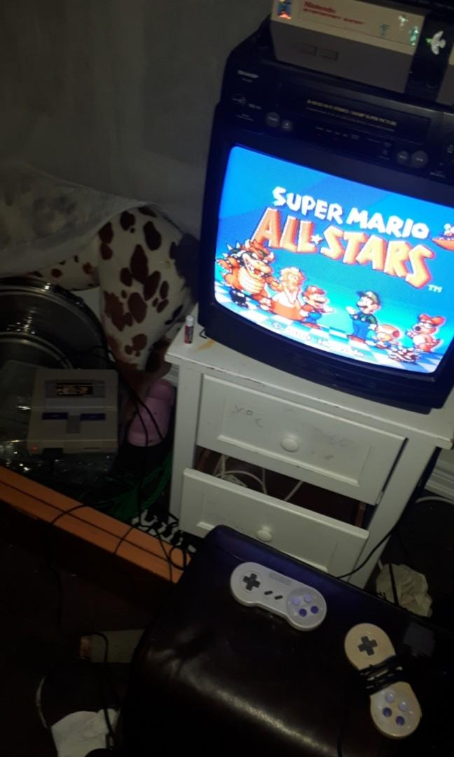 Super Nintendo with Super Mario All Stars and two controllers!