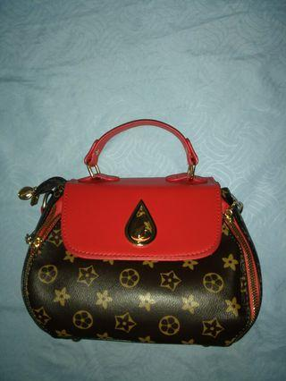 Red brown sling bag