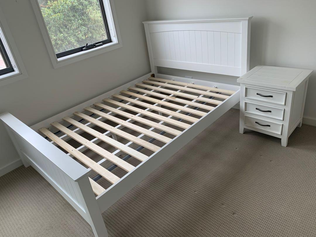 White wooden double bed with firm mattress and bed side drawers