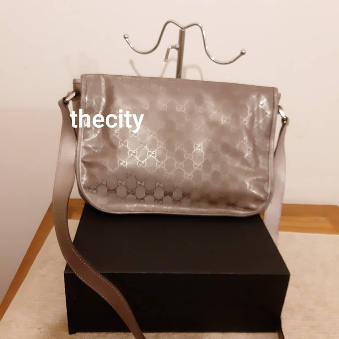 AUTHENTIC GUCCI SHINY METALLIC MONOGRAM GG LOGO DESIGN SLING MESSENGER BAG- CLEAN INTERIOR, OVERALL GOOD - SHADOWS ON THE BAG ARE LIGHT REFLECTIONS -