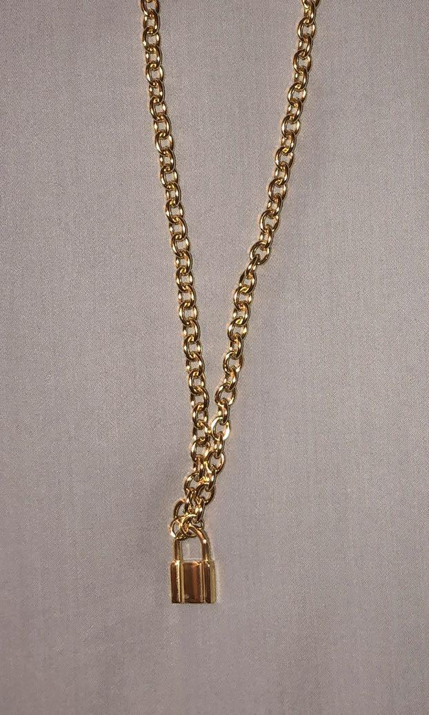 brandy melville gold lock necklace (brand new)