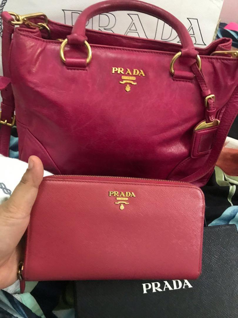 Prada Bag & Signature saffiano leather with golden hardware. Zip-around wallet. Interior zip pocket. Eight credit card slots. Two billfold pockets.