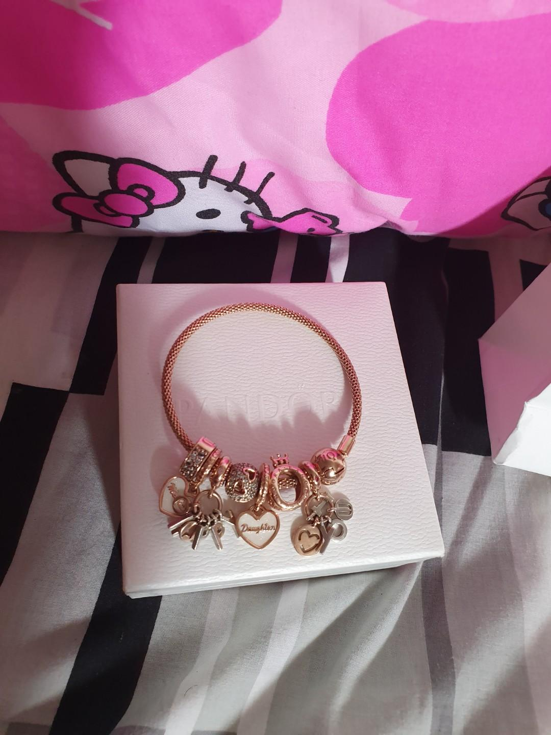 Pandora rose gold bracelet and charms