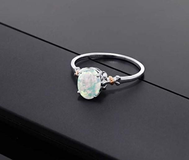 Gem Stone King 925 Sterling Silver and 10K Rose Gold Ring Oval Cabochon White Simulated Opal 0.63 cttw