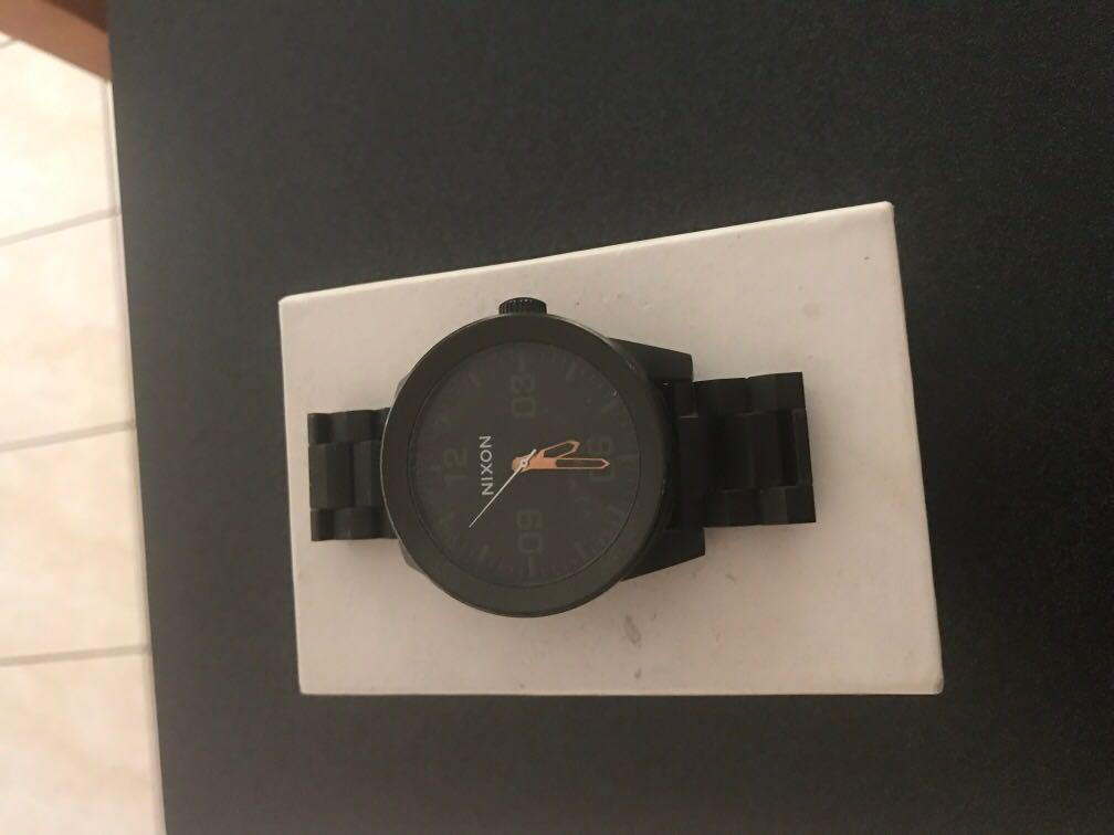 All black nixon watch