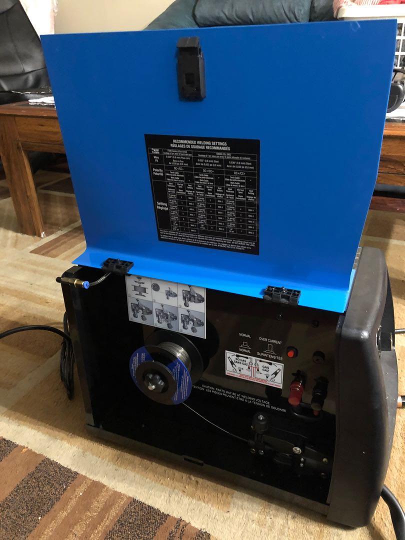 Mastercraft  Mig/flux-core wire feed welder & helmet