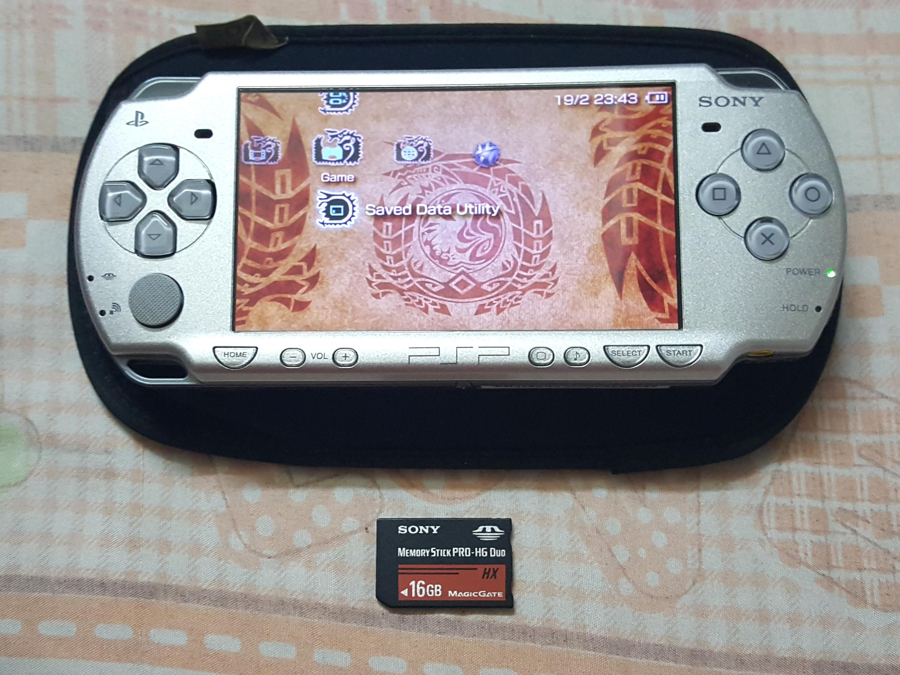PSP 2006, It's Silver Color * NO CHARGER! *.  It Comes With 16GB Memory Card + 3 Games Has Been Added In The 16GB Card.  100% Working PSP!.