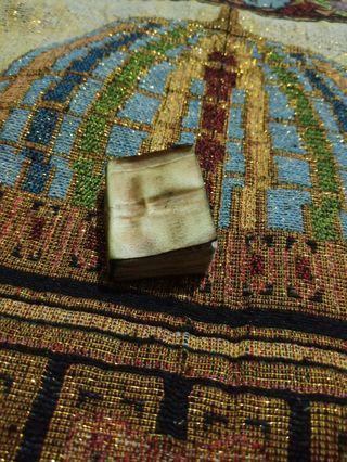 Kitab wafaq kecil berkulit kijang putih