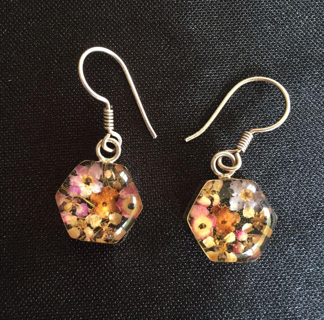 Adorable tiny dried flowers in resin , silver setting