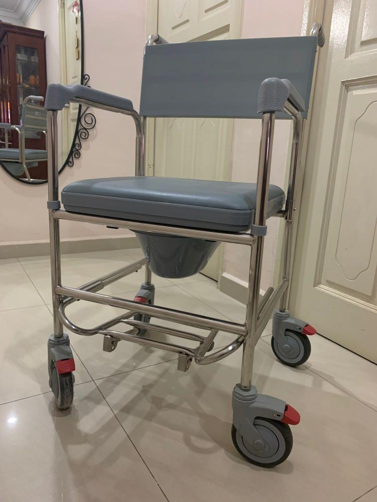 Rolling shower and commode transport chair with wheels and padded seat for handicap