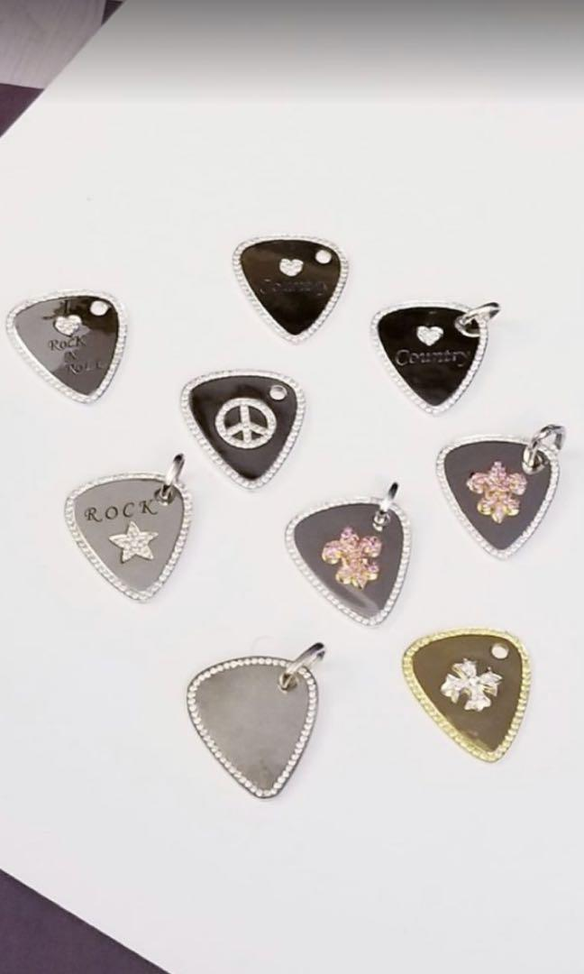 Collection of solid 14CT White Gold and diamond Guitar picks pendants