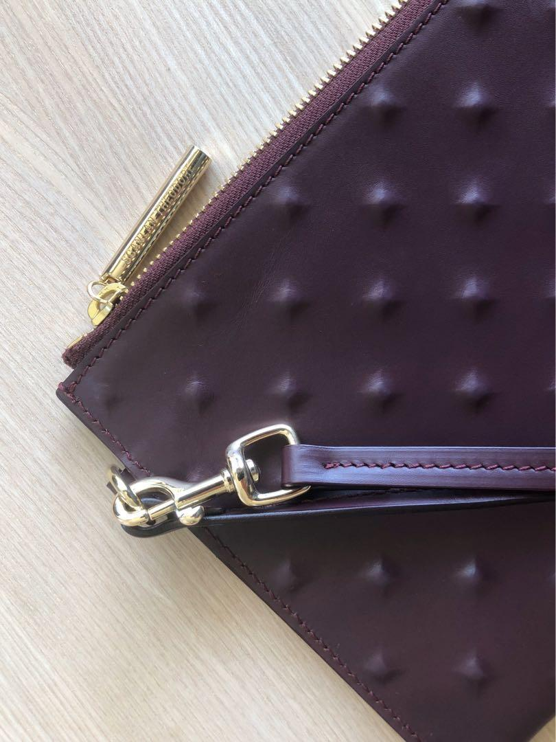Scanlan Theodore burgundy leather clutch with strap