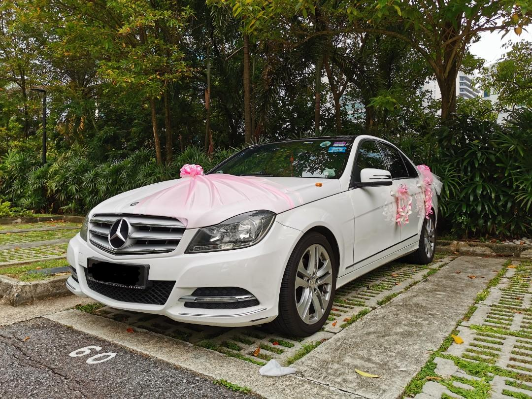 Innocence White Mercedes Benz C180 with nice 2-digit number and Sun Roof for Wedding Rental