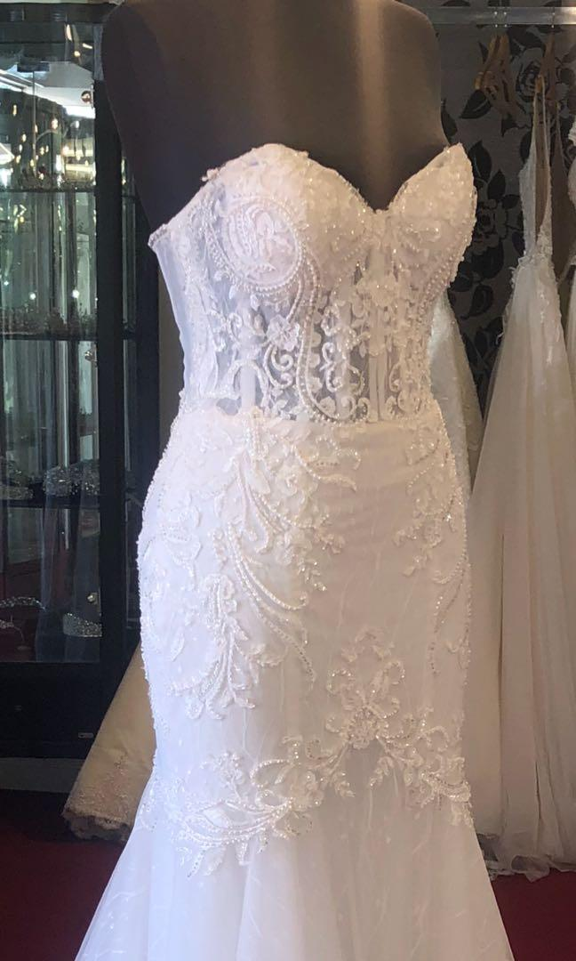 Stunning mermaid beaded crystal wedding dress. Only worn for a few hours!! Purchased for $4000 and 6K RRP