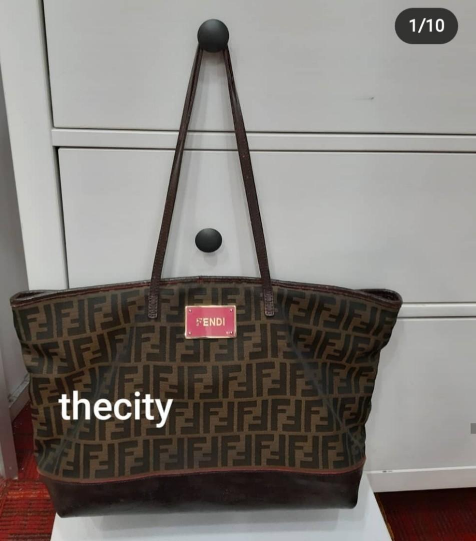 AUTHENTIC FENDI MONOGRAM LOGO DESIGN SHOULDER BAG- CLEAN INTERIOR- LEATHER TRIMS HAVE BEEN RECOLORED AT BAGSPA, SO NOT FOR FUSSY BUYERS - CLEAN INTERIOR- HOLOGRAM TAG INTACT- (FENDI SHOULDER BAGS NOW RETAIL OVER RM 10,0000+)