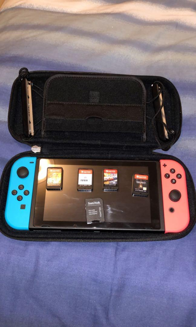 Nintendo Switch(Includes 4 Games and 32GB SD Card)
