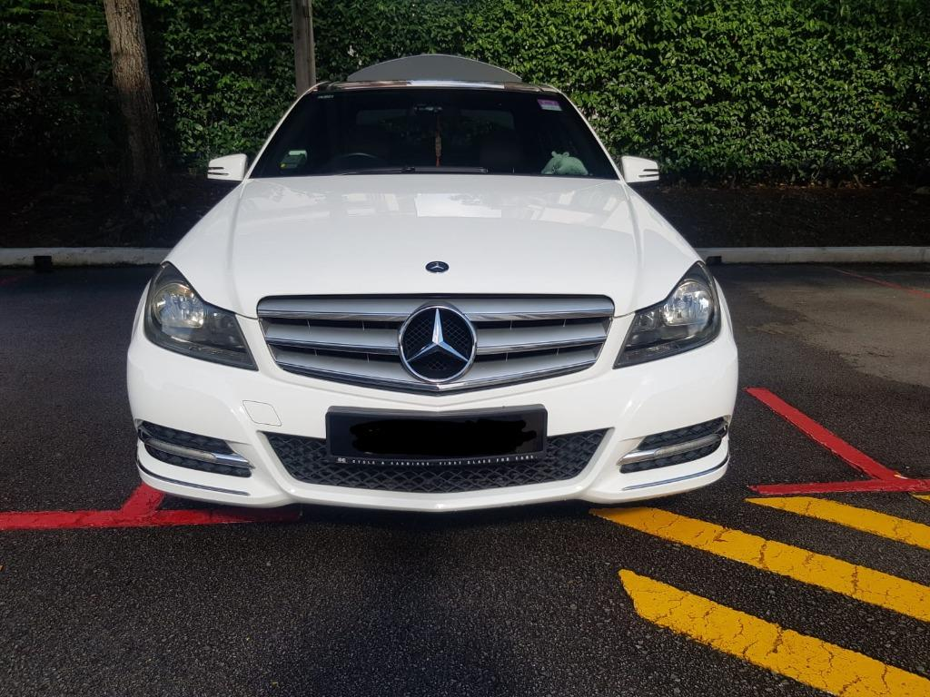 Clean and Neat White Mercedes Benz C180 for Your Transportation Needs