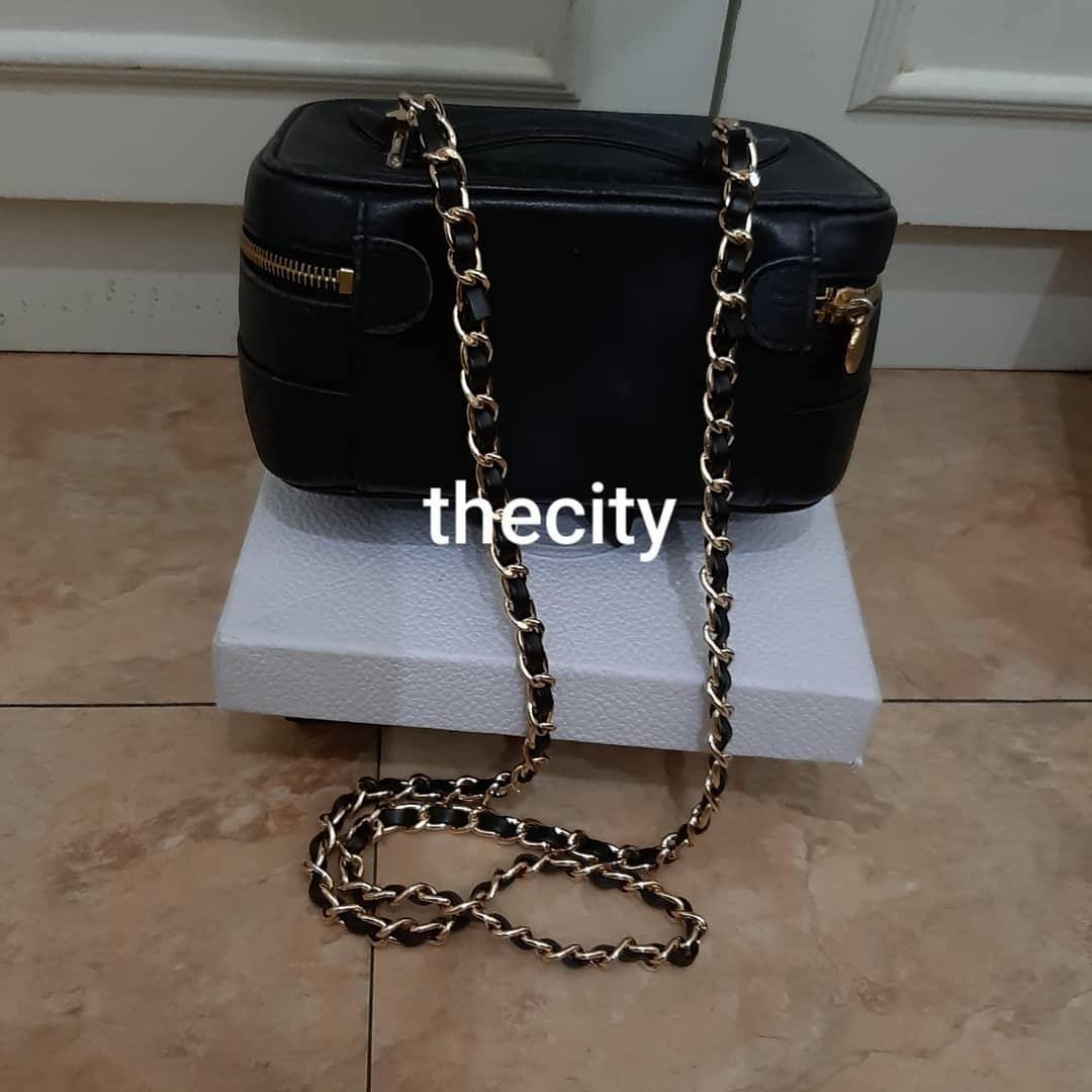 AUTHENTIC CHANEL BLACK LAMBSKIN LEATHER VANITY BAG - GOLD HARDWARE - HOLOGRAM STICKER INTACT- WITH EXTRA ADD. LONG CHAIN STRAP FOR CROSSBODY SLING- CLEAN INTERIOR - CLASSIC TIMELESS VINTAGE, SO NOT FOR FUSSY BUYERS -