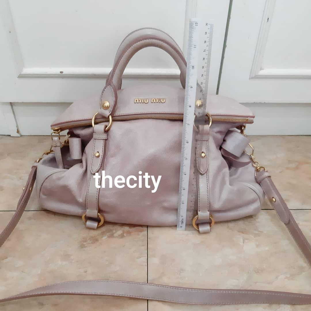 AUTHENTIC MIU MIU MEDIUM LEATHER TOTE BAG WITH ITS ORIGINAL LONG STRAP FOR CROSSBODY SLING - CLEAN INTERIOR & POCKET - LEATHER EXTERIOR IN GOOD CONDITION - COMES WITH ITS PRODUCT ID CARD TAG