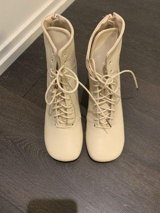 Ivory leather high heels boots