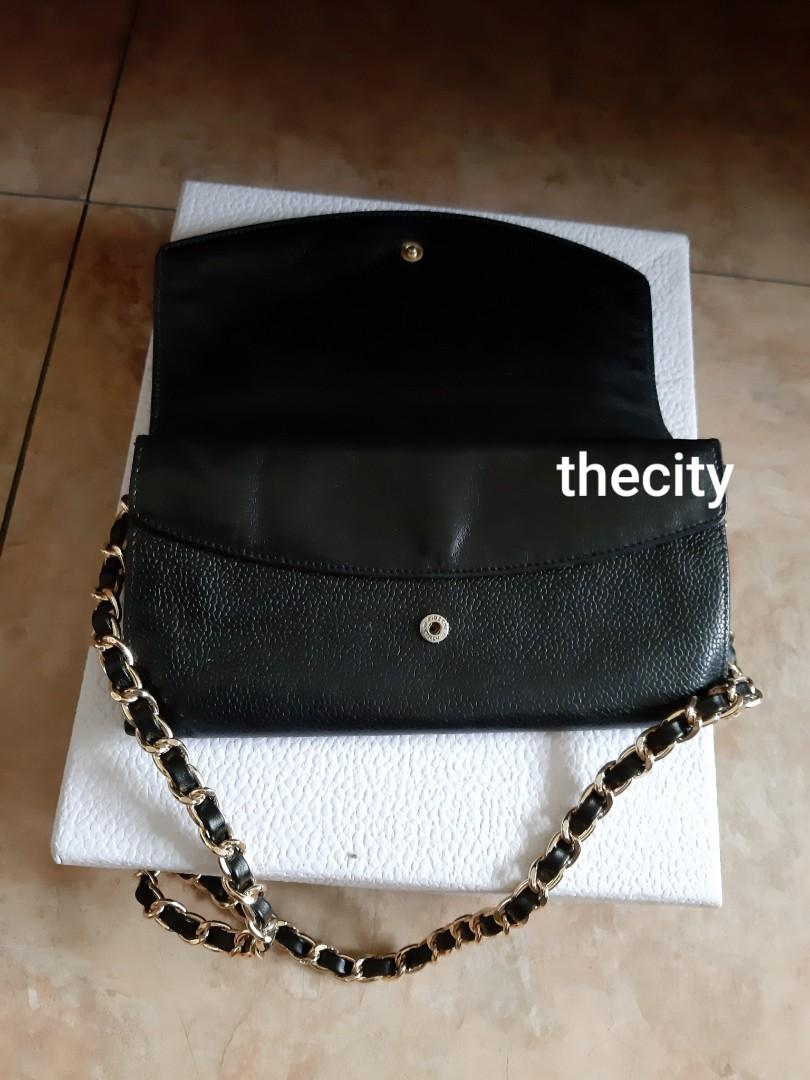 AUTHENTIC CHANEL BLACK CAVIAR LEATHER- LONG ORGANIZER POUCH / WALLET- CC LOGO DESIGN - LEATHER IN GOOD CONDITION, CLEAN INTERIOR-  COMES WITH AUTHENTICITY CARD - CLASSIC TIMELESS VINTAGE,  SO NOT FOR FUSSY BUYERS - COMES WITH EXTRA ADD HOOKS & CHAIN STRAP