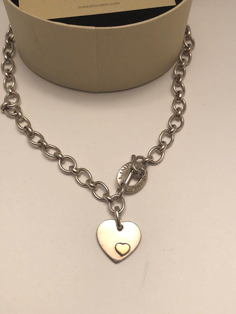 Links of SOLD! London sterling silver necklace with heat pendant
