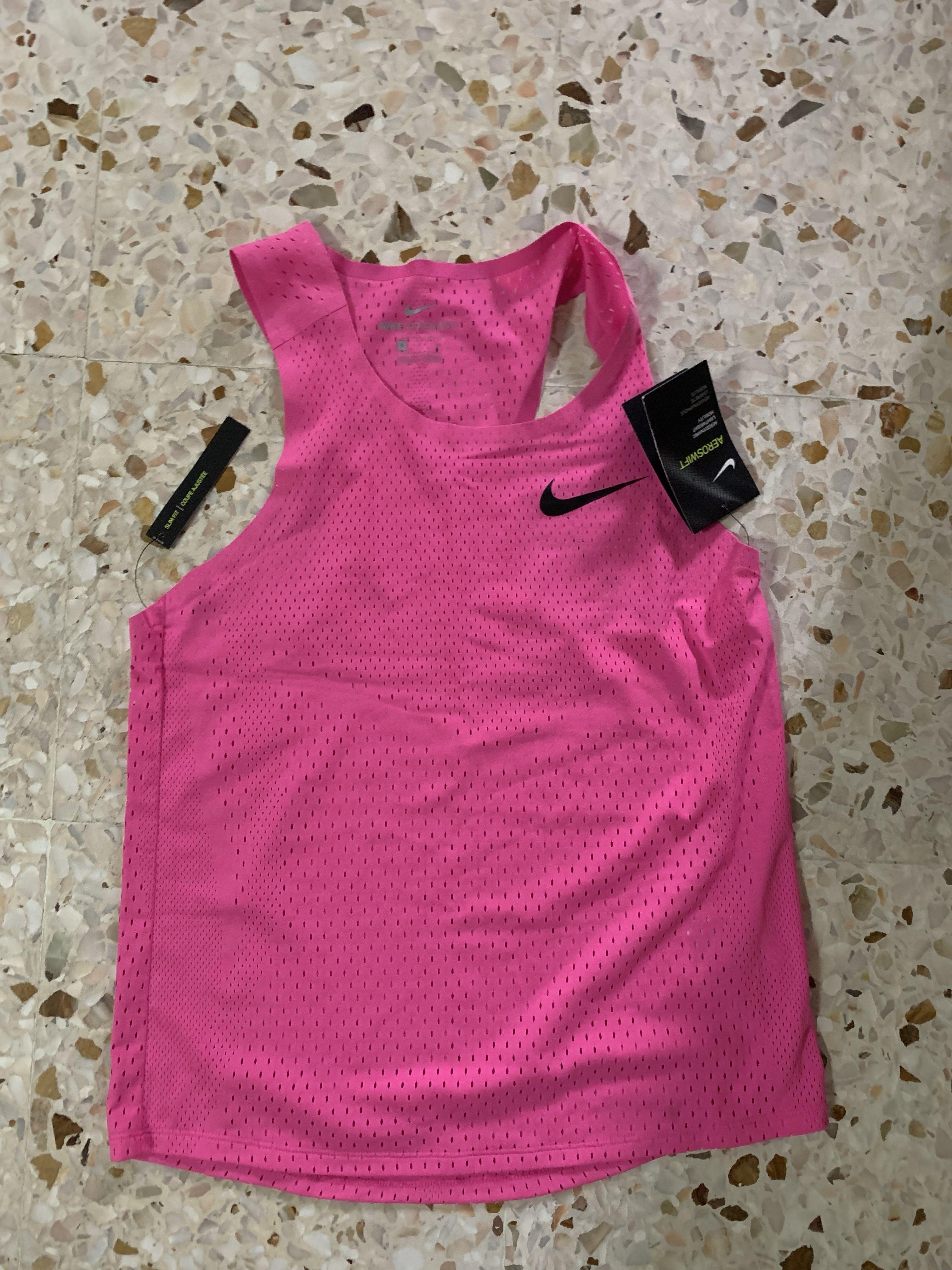 fuga de la prisión contar Ausencia  Nike aeroswift singlet pink Small men's, Sports, Sports Apparel on Carousell