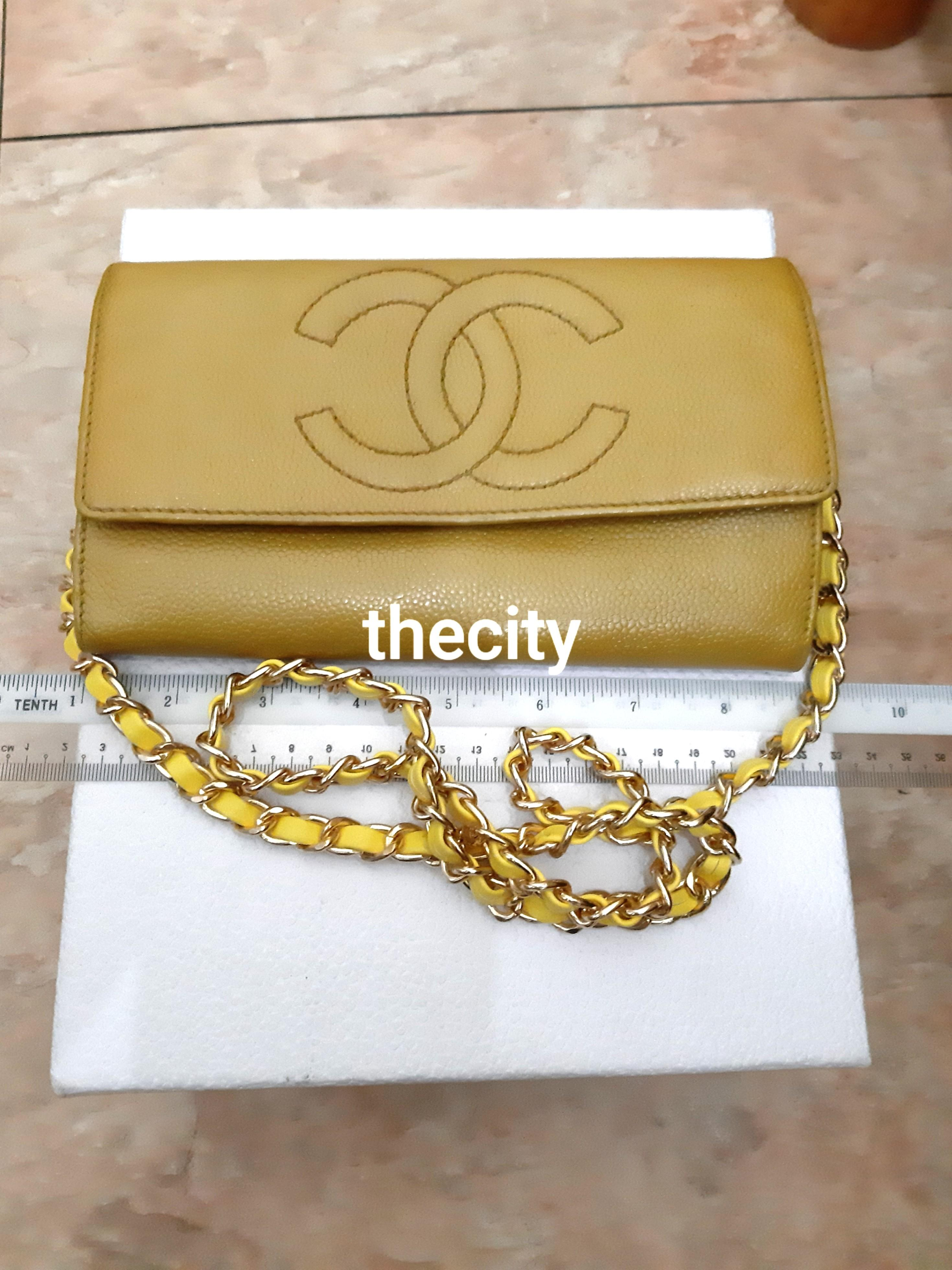 AUTHENTIC CHANEL CAVIAR LEATHER- XL ORGANIZER POUCH / WALLET- CC LOGO DESIGN - CAVIAR LEATHER IN GOOD CONDITION, INTERIOR LINING IS ABIT WRINKLED / SEASONED - GOLD HARDWARE- COMES WITH EXTRA ADD HOOKS & LONG CHAIN STRAP FOR CROSSBODY SLING