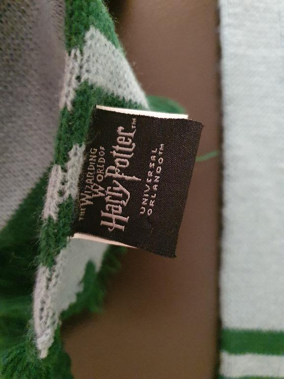 NWOT Slytherin Green Logo Scarf bought from Universal Studios in Orlando Florida NWOT Slytherin Green Logo Scarf bought from Universal Studios in Orlando Florida. Warm and soft material.