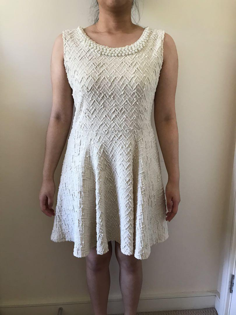 Cream dress with pearl neckline and textured material