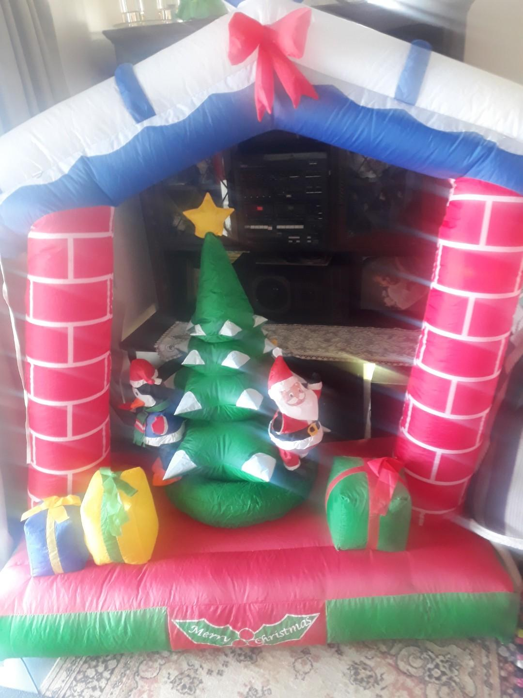 Merry Christmas spirited pop up with rotating xmas tree blow up beauty