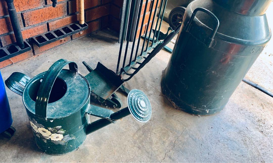 Antique milk urn/shoe rack/wheelbarrow/watering can