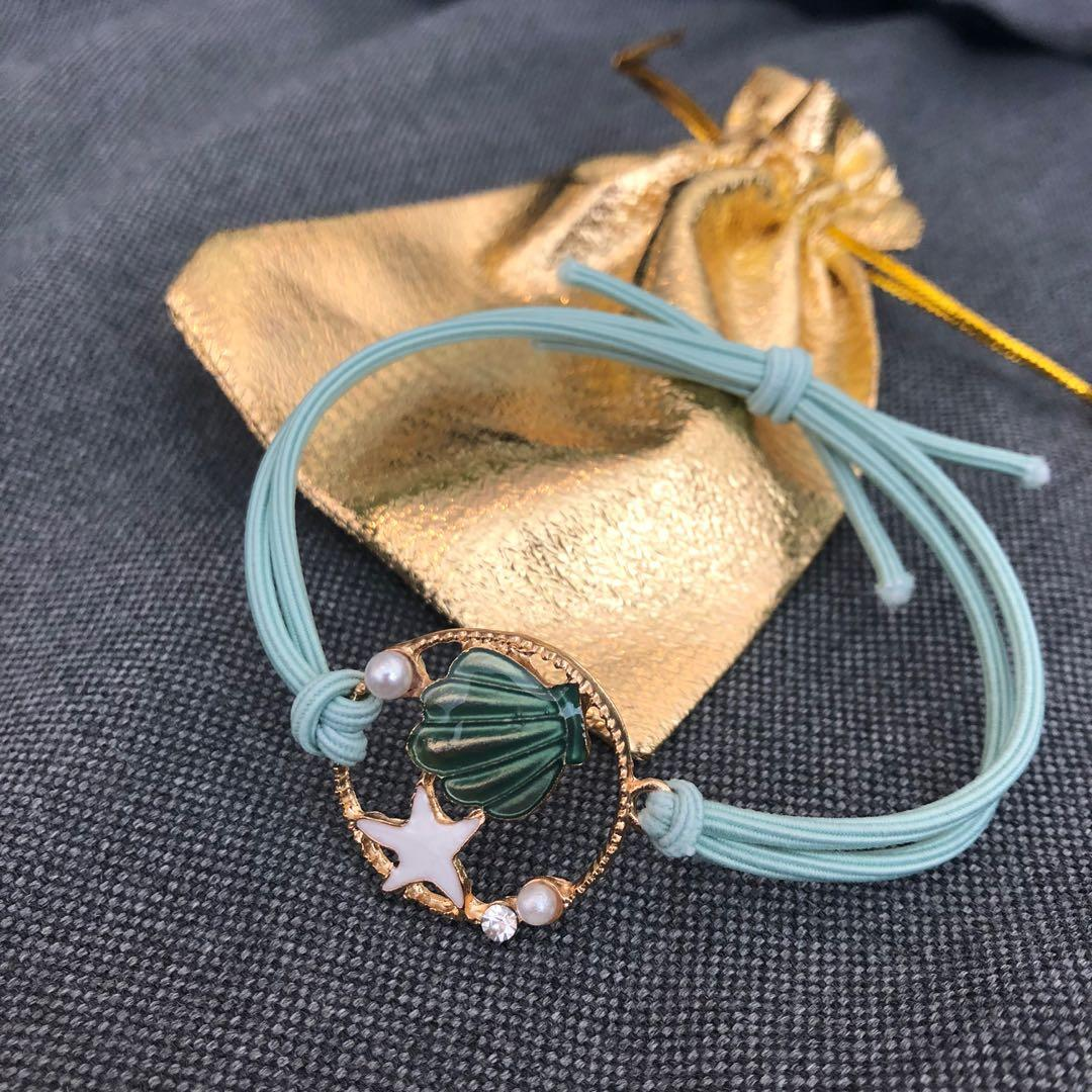 Brand new sea shell and star green bracelet / hair band